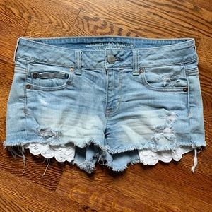 American Eagle denim shorts with lace pockets